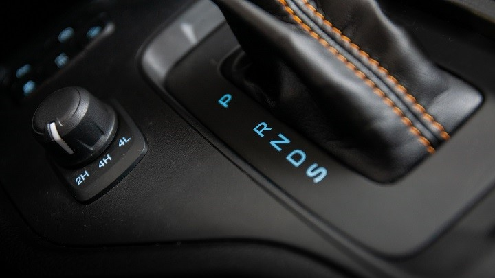 Close up of automatic gearshift and drive setting dial