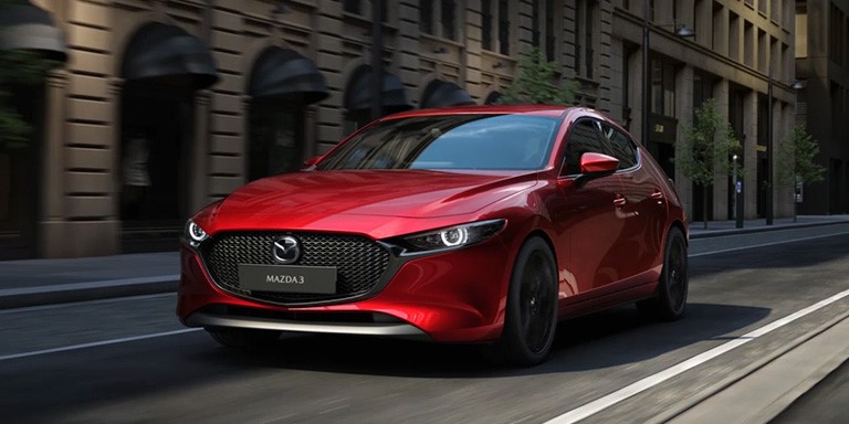 All-New Mazda3 in Soul Red Crystal driving along highstreet