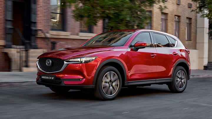 Red Mazda CX-5 driving in the city