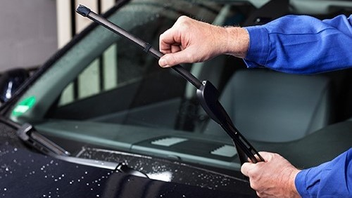 car windscreen wipers being checked over