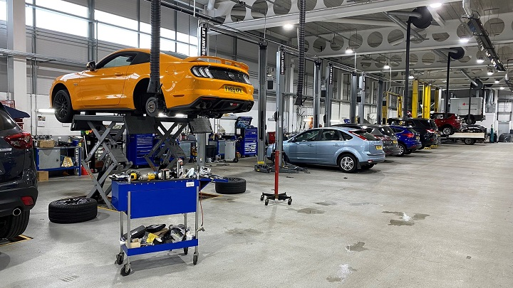 Orange Mustang 5.0 V8 hoisted ready to be fitted with IRS Kit