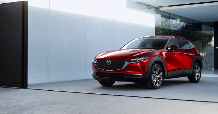 Mazda CX-30 crossover SUV parked in driveway.