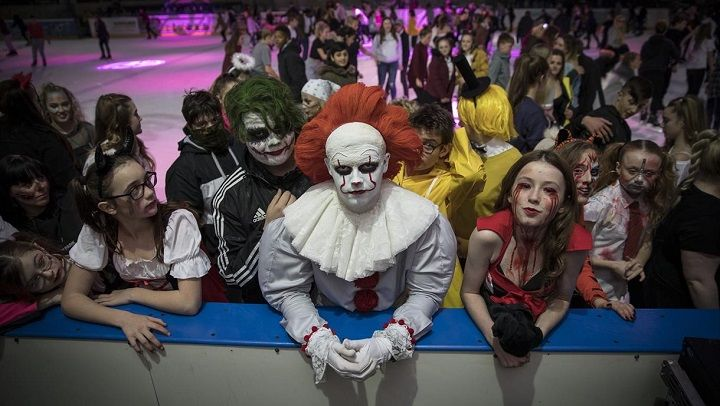 Group of people dressed in Halloween costumes at the National Ice Centre, Nottingham