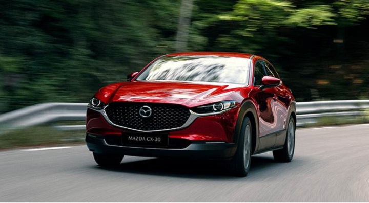 All-New Mazda CX-30 driving on motorway, front exterior shot.