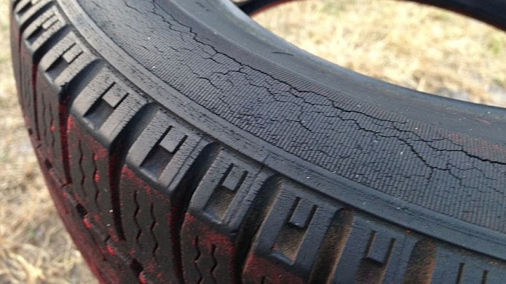 Rubber car tyre showing sidewall cracking