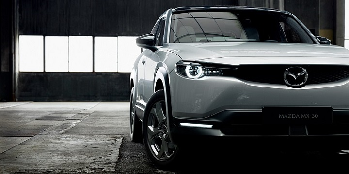New Mazda MX-30 front exterior shot with front grille, headlights and wheels.