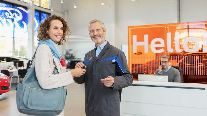 Customer collecting new car from dealership