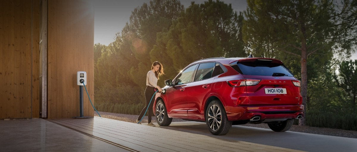 All-New Ford Kuga PHEV being charged with wall charge station