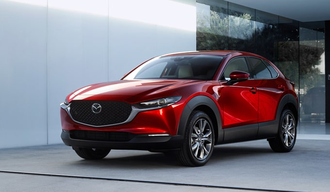 New generation Mazda CX-30 driving on road using i-Activsense Mazda Radar Cruise Control safety feature.
